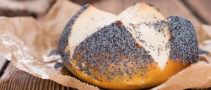 Fresh baked Pretzel Roll with Poppyseed (close-up shot)